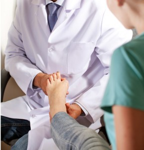 Doctor treating ankle injury