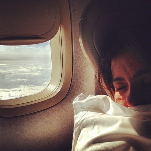 Woman asleep on plane