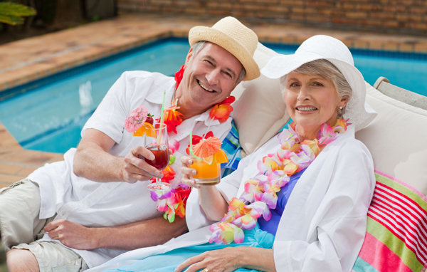 Older man and woman at poolside