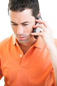 Worried man talking on phone