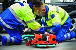 Paramedics help a patient