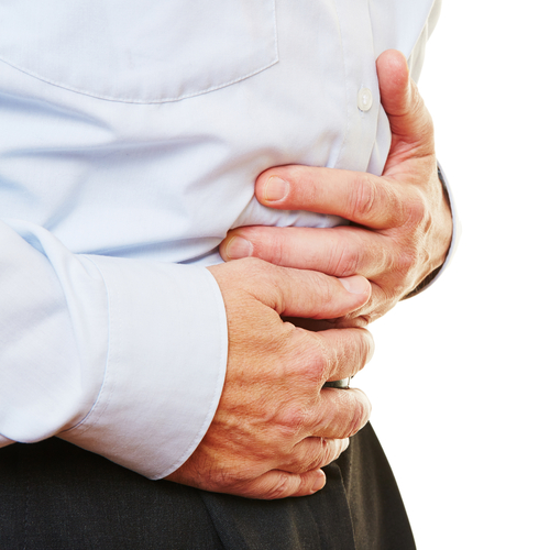 Business man holding stomach in pain