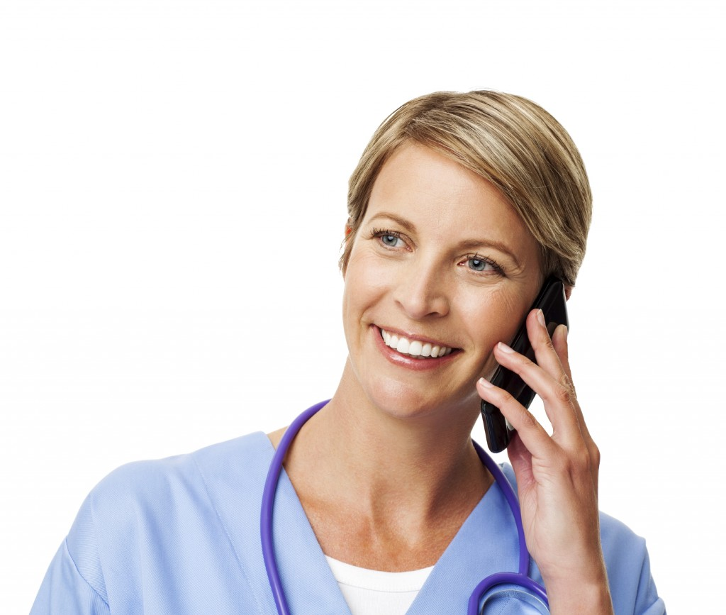 Smiling Nurse Answering Smart Phone