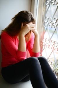 Female student headache_worried sitting