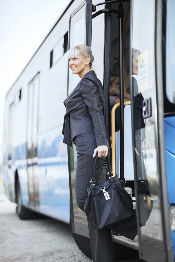 Businesswoman getting off the bus.