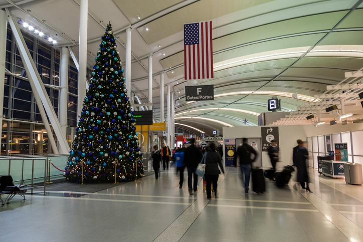 U.S.A. flag and gate number beside Christmas tree